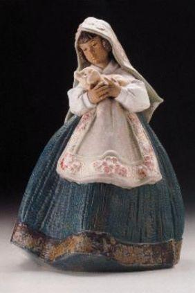 Comprar online Figura niña con cerdito de Lladró 2356
